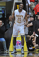 WICHITA, KS - JANUARY 18:  Forward Kadeem Coleby #20 of the Wichita State Shockers reacts after blocking a shot against the Indiana State Sycamores during the second half on January 18, 2014 at Charles Koch Arena in Wichita, Kansas.  (Photo by Peter G. Aiken/Getty Images) *** Local Caption *** Kadeem Coleby