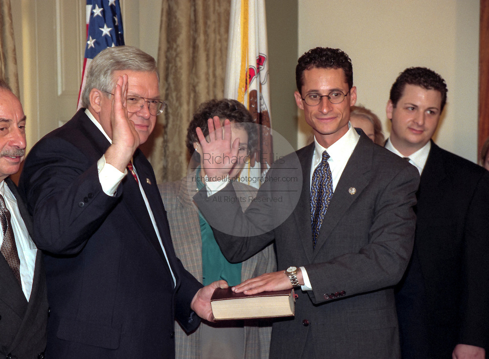 Speaker of the House Denis Hastert (L) administers the oath of office to Rep. Alan Weiner of New York as his family looks on January 6, 1999 at the start of the 106th Congress. The oath is a recreation as the formal oath is administered to the entire congress as a body on the floor of the House.