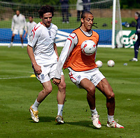 Photo: Richard Lane.<br />England Training Session. 22/05/2006.<br />Rio Ferdinand holds the ball up in front of Owen Hargreaves.