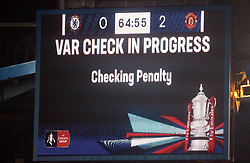A general view of the scoreboard displaying a VAR check in progress during the FA Cup fifth round match at Stamford Bridge, London.