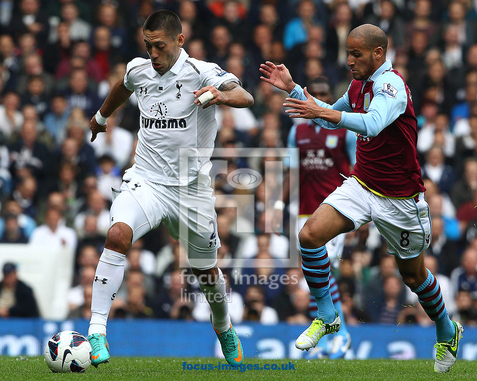 Picture by Paul Terry/Focus Images Ltd +44 7545 642257.07/10/2012.Clind Dempsey of Tottenham Hotspur and Karim El Ahmadi of Aston Villa during the Barclays Premier League match at White Hart Lane, London.