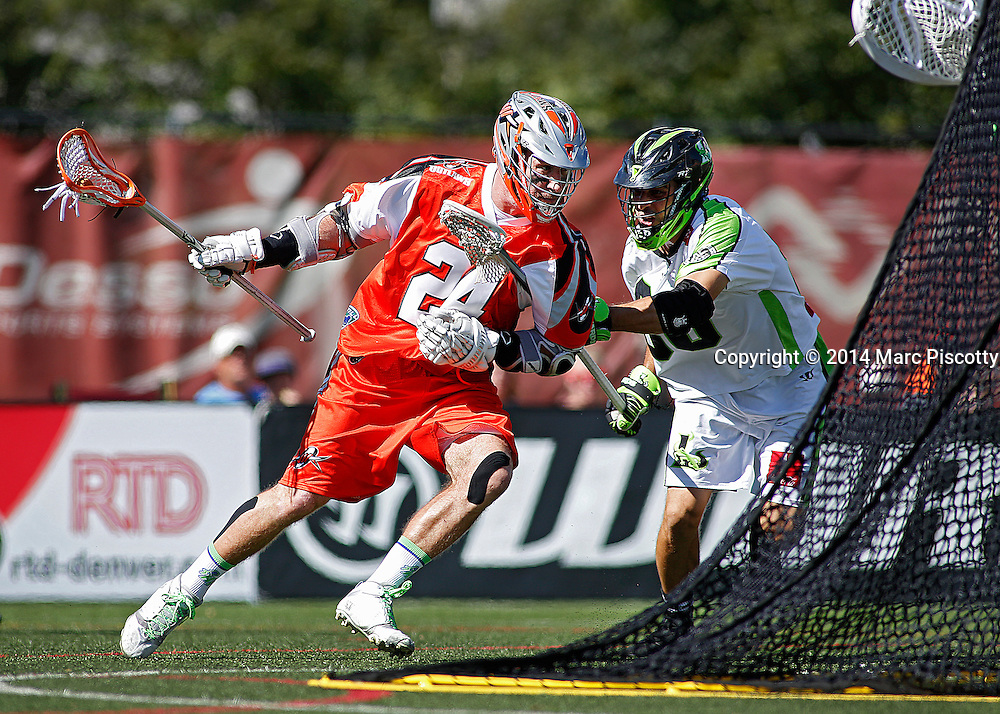 SHOT 8/16/14 3:46:49 PM - The Denver Outlaws John Grant Jr. #24 drives to the net in front of the New York Lizards Steve Holmes #80 during their MLL Semifinals matchup at Peter Barton Lacrosse Stadium on the University of Denver campus in Denver, Co. Saturday. The Denver Outlaws won the game 14-13 to advance. (Photo by Marc Piscotty / © 2014)