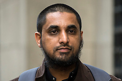 © Licensed to London News Pictures. 11/01/2016. London, UK. Islamic preacher MOHAMMED RAHMEN arrives at The Old Bailey in London for a hearing ahead his trial for inviting support for terrorist group ISIL, which is due to start tomorrow (tues). Mohammed Rahmen and Anjem Choudary are alleged to have invited support for the Islamic State group in individual lectures which were subsequently posted online. Photo credit: Ben Cawthra/LNP