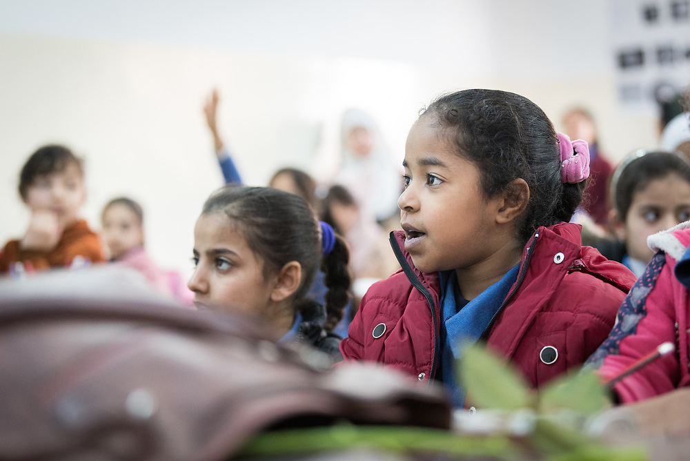 18 February 2020, Amman, Jordan: Girls attend class at the Rufaida Al Aslamieh Primary Mixed School in the Sahab district. The school serves more than 1,000 students from kindergarten up to 10th grade, most of them girls from Jordan but also some from Syria and other countries, and, in the lower grades, also boys.