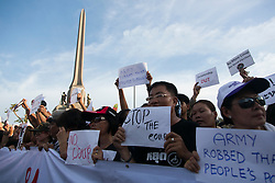 © Licensed to London News Pictures. 24/05/2014. Anti-coup protestors outside Victory monument following a Anti-Coup protest in Bangkok Thailand. The Royal Thai army announced a Military coup and have imposed a 10pm curfew.  Photo credit : Asanka Brendon Ratnayake/LNP