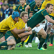 James Horwill, (left) and David Pocock, Australia, combine to tackle Francois Hougaard, South Africa, during the South Africa V Australia Quarter Final match at the IRB Rugby World Cup tournament. Wellington Regional Stadium, Wellington, New Zealand, 9th October 2011. Photo Tim Clayton...