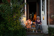 The number of UK deaths from Coronavirus, a further 363 victims taking the total to 35,704, coincided with the hottest day of the year so far, with 27.8 degrees recorded at Heathrow Airport, and a mother and daughter read their books on the steps of their homes porch in late sunshine while still under the UK governments lockdown rules of social distancing - during a warm evening in Lambeth, south London, on 20th May 2020, in London, England.