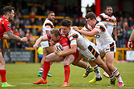 Bradford Bulls second row James Bentley (20) and Bradford Bulls replacement Brandon Wilkinson (21) join forces in the tackle during the Kingstone Press Championship match between Dewsbury Rams and Bradford Bulls at the Tetley's Stadium, Dewsbury, United Kingdom on 10 September 2017. Photo by Simon Davies.