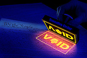 The Constitution is stamped VOID with a glowing executive order stamp.Black light