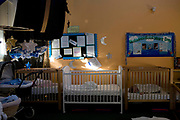 Babies sleeping in cots in the mother and baby unit. HMP/YOI Askham Grange is a women's open prison serving the Yorkshire area with a capacity of 128 women. It has extensive education, training and mother and Baby facilities.