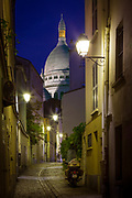 The dome of Sacre Coeur seen from a backsteet in Paris' Montmartre area