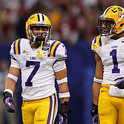 Jan 9, 2012; New Orleans, LA, USA; LSU Tigers cornerback Tyrann Mathieu (7) and safety Eric Reid (1) during the first half of the 2012 BCS National Championship game against the Alabama Crimson Tide at the Mercedes-Benz Superdome.  Mandatory Credit: Derick E. Hingle-US PRESSWIRE