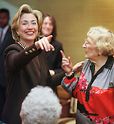 First Lady Hillary Rodham Clinton chats about protecting Social Security and getting out the vote with Sylvia Margolis, 83, right, and other seniors October 31, 1998, at Brookdale Living Communities Inc.'s The Hallmark, an upscale retirement community in Chicago. Mrs. Clinton made several appearances in town in support of Sen. Carol Moseley-Braun's re-election bid.  Photo by John Zich