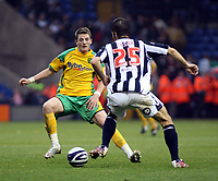 Photo: Mark Stephenson.<br /> West Bromwich Albion v Norwich City. Coca Cola Championship. 27/10/2007.Norwich's  on the ball from West Brom's Bostjan Cesar