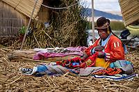 UROS ISLANDS, PERU - CIRCA October 2015: Woman from the Uros Islands in Lake Titicaca.