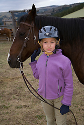 United States, Montana, Livingston, girl (age 8) with horse at dude ranch  MR