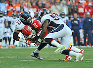 KANSAS CITY, MO - DECEMBER 01:  Linebackers Wesley Woodyard #52 and Danny Trevathan #59 of the Denver Broncos tackle wide receiver Junior Hemingway #88 of the Kansas City Chiefs during the first half on December 1, 2013 at Arrowhead Stadium in Kansas City, Missouri.  (Photo by Peter G. Aiken/Getty Images) *** Local Caption *** Wesley Woodyard;Danny Trevathan;Junior Hemingway
