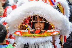 © Licensed to London News Pictures. 29/01/2017. London, UK.   A girl takes part in lion dancing as the Chinese New Year parade takes place around Chinatown to celebrate the Year of the Rooster. Photo credit : Stephen Chung/LNP