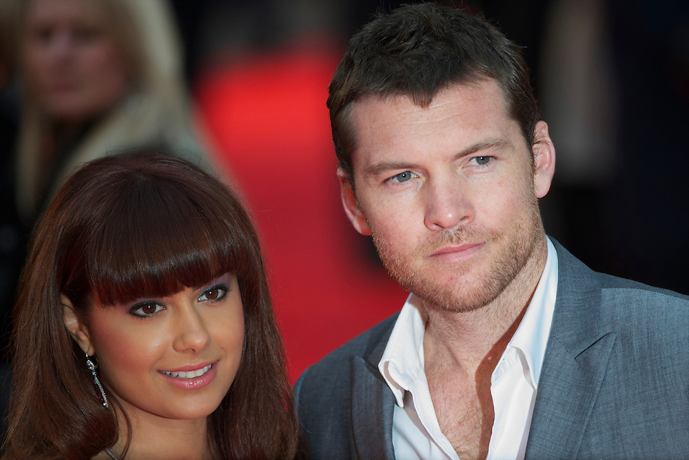 """Actor Sam Worthington and girlfriend attend the world premiere of """"The Clash of the Titans,"""" a remake of the 1981 film, at Empire Leicester Square, London.  With a narrative inspired by the Greek myth of Perseus, Leicester Square was transformed into a ancient Greek setting, complete with a legion of soldiers, columns and scultpture ruins."""