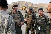 """US Marine Colonel Jeff Haynes, Commanding Officer, 201st Regional Corps Advisory Command, (left) and US Marine Sgt Major Patrick Dougherty (center) with ANA Sgt Major Armanzi inspecting ANA progress in the Tagab Valley.  In the back ground is heavy equiptment used to grade the road.   ....One of the main tactics is a new road through Tagab Valley that will allow traffic to bypass Kabul providing a more direct link between Pakistan and destinations north including Uzbekistan and Tajikistan.....To win the Tagab Valley, Colonel Haynes said, """"The creeping barrage of goodness, really centers on the road going up the valley, because then you can begin development projects and increase prosperity.  The cab fare for villagers went from $8 down to $1 just because the ANA graded the road.""""  As the ANA move north through the valley they are building combat outposts to sustain the gains.  Haynes confirmed this is an ANA campaign - the first of its kind - his soldiers are mentoring the ANA, there are no coalition troops.  .."""