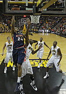 December 29 2010: Illinois Fighting Illini forward Mike Davis (24) puts up a shot over Iowa Hawkeyes forward Melsahn Basabe (1) during the first half of an NCAA college basketball game at Carver-Hawkeye Arena in Iowa City, Iowa on December 29, 2010. Illinois defeated Iowa 87-77.
