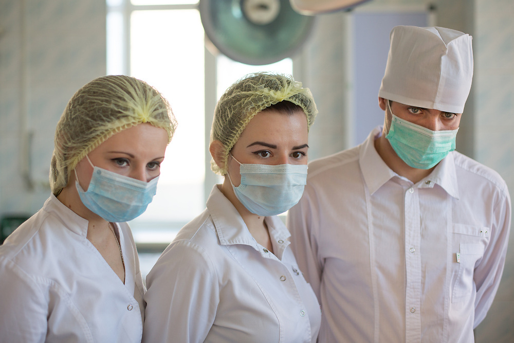 CAPTION: Three Fifth Year dental students from Volgograd State Medical University observe proceedings intently. LOCATION: Volgograd City Hospital #1, Volgograd, Russia. INDIVIDUAL(S) PHOTOGRAPHED: Three Fifth Year dental students from Volgograd State Medical University.