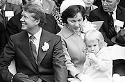 Georgia state senator and governor elect Jimmy Carter at his 1971 gubernatorial inauguration. Carter succeeded segregationist Lester Maddox as Georgia governor. Carter is seated with his wife Rosalyn and daughter Amy.