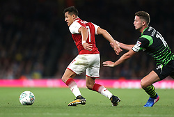 20 September 2017 London : EFL Cup Football : Arsenal v Doncaster Rovers : Alexis Sanchez of Arsenal is pulled back by Jordan Houghton of Doncaster.<br /> Photo: Mark Leech