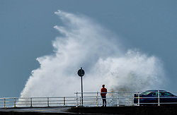 © London News Pictures. 16/10/2017. Aberystwyth, UK. The remnants of storm system Ophelia , with Hurricane Force 12 winds gusting up to 80mph,  batter the sea defences at Aberystwyth on the Cardigan Bay coast of the Irish Sea in west Wales. The Met Office has issued an Amber weather warning, with a good chance that power cuts may occur, with the potential to affect other services, such as mobile phone coverage.. Photo credit: Keith Morris/LNP