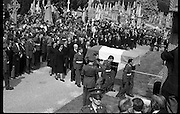 Funeral of Eamon DeValera.   (J72)..1975..02.09.1975..09.02.1975..2nd September 1975..Today saw the funeral of Eamon DeValera. He was laid to rest beside his wife Sinead in Glasnevin Cemetery,Dublin. Dignitries from all around the world attended at the funeral..Image of the family and friends of Eamon DeValera following closely behind the Tricolour draped coffin containing his remains.