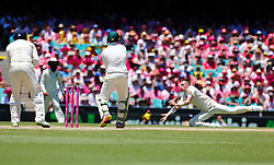 England'sMason Crane attempts to catch Usman Khawaja during day two of the Ashes Test match at Sydney Cricket Ground.