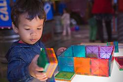 Washington, Bellevue, KidsQuest Children's Museum, boy building with plastic tiles