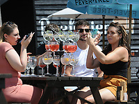 Horse Racing - Epsom Festival - Derby Day - Epsom Downs<br /> <br /> Race goers line up the drinks as they watch the first race of the day at The Tattenham Corner Pub behind the fences to stop the public entering the course<br /> <br /> Credit : COLORSPORT/ANDREW COWIE