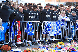 Leicester City Youth Team Coach Steve Beaglehole (left) and members of the Leicester City Youth Team pay tribute at Leicester City Football Club. Leicester Chairman, Vichai Srivaddhanaprabha, was among those to have tragically lost their lives on Saturday evening when a helicopter carrying him and four other people crashed outside King Power Stadium.