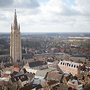 A view out over the city of Bruges from the top of the Belfry of Bruges. The Belfry (or Belfort) is a medieval bell tower standing above the Markt in the historic center of Bruges. The first stage was built in 1240, with further stages on top built in the late 15th century.