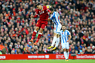 Roberto Firmino of Liverpool (l) and Jonathan Hogg of Huddersfield Town jump for the ball. Premier League match, Liverpool v Huddersfield Town at the Anfield stadium in Liverpool, Merseyside on Saturday 28th October 2017.<br /> pic by Chris Stading, Andrew Orchard sports photography.