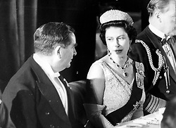 *Scanned low-res off print, high res available on request* Queen Elizabeth II talking with Denis Healey, the Defence Secretary and one of the hosts, at the Royal Air Force golden jubilee banquet and reception at Lancaster House, St. James's, London.