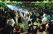 La Ganga' s wedding. She dances in her third, carnival, wedding dress, surrounded by extended family and and friends. Montpellier, France October 1995