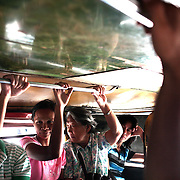 A street view in a Jeepney. Jeepneys are the most popular means of public transport in the Philippines. They were originally made from US military jeeps left over from World War 2 and are well know for their flamboyant decoration and crowded seating. They are a symbol of Philippine culture. on October 8, 2008 at Divasoria markets, Manila, the Philippines. Photo Tim Clayton