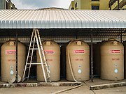 16 MARCH 2016 - PRACHIN BURI, PRACHIN BURI, THAILAND: Water tanks at Abhaibhubet Hospital in Prachin Buri. The drought in Thailand is worsening and has spread to 14 provinces in the agricultural heartland of Thailand. Communities along the Bang Pakong River, which flows into the Gulf of Siam, have been especially hard hit since salt water has intruded into domestic water supplies as far upstream as Prachin Buri, about 100 miles from the mouth of the river at the Gulf of Siam. Water is being trucked to hospitals in the area because they can't use the salty water.        PHOTO BY JACK KURTZ