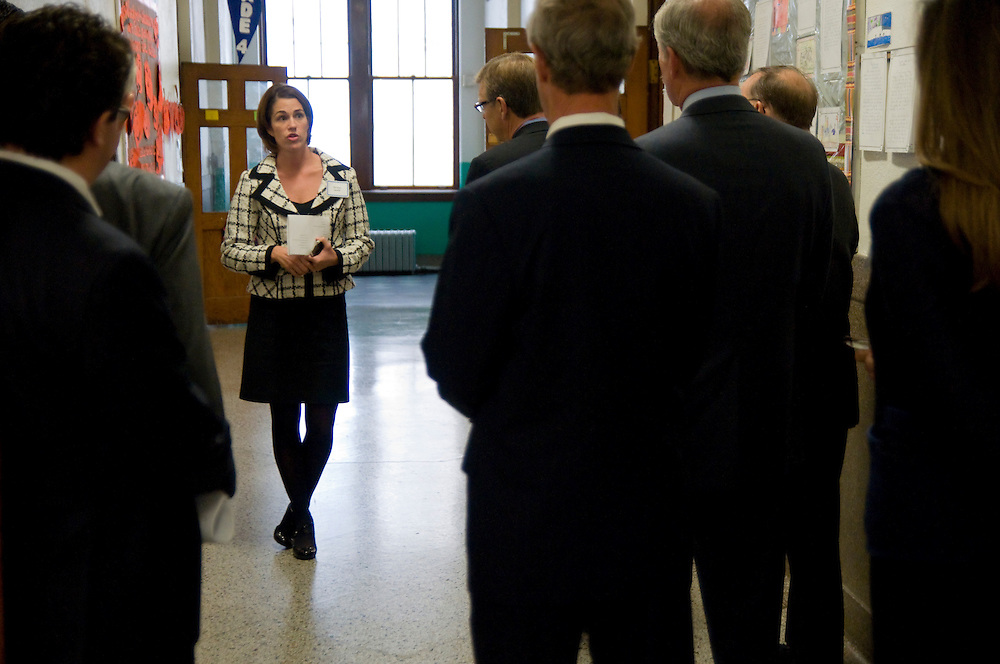 St. Angela's Catholic School Director of Development Geralyn Lawler leads civic and corporate leaders on a tour as the school hosts Lend a Shoulder Day, an annual event promoting the Big Shoulders Fund. The Fund has raised 193 million dollars since 1986 that are granted to 93 Catholic schools for tuition and operating costs.