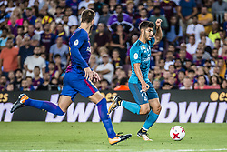 August 13, 2017 - Barcelona, Catalonia, Spain - Real Madrid midfielder ASENSIO competes with FC Barcelona defender PIQUE for the ball during the Spanish Super Cup Final 1st leg between FC Barcelona and Real Madrid at the Camp Nou stadium in Barcelona (Credit Image: © Matthias Oesterle via ZUMA Wire)