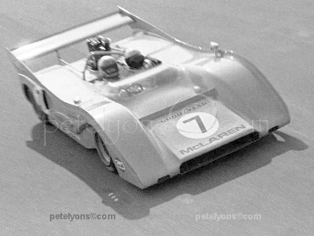 Peter Revson, Can-Am champion of 1971, giving rides in his McLaren M8F at Riverside.