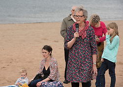 Pictured: local councillor, Maureen Child says a few words in tribute to Jo Cox<br /> <br /> Portobello resident and former colleague of murdered MP Jo Cox, Kim Wallace, organised a tribute event on Portobello beach at which locals were invited to remember Jo and to light candles for her.<br /> <br /> <br /> © Jon Davey/ EEm