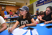 """Volunteers from Keep Tucson Together and attorney Margo Cowan provide legal assistance to persons effected by changes to DACA, or Deferred Action Childhood Arrival, which provided legal protection to those brought into the United States illegally as children, at a clinic at Pueblo Magnet High School, Tucson, Arizona, USA. """"Edna"""", 21, entered the USA on a legal visa at the age of 9, along with her family.  Her father intended to stay in the USA to work. Her family chose to overstay their visas to avoid prolonged separation from her father.  She applied for and was granted DACA status, which lapsed in August, 2017.  With changes to DACA, she faces possible deportation if stopped by law enforcement.  She is a nursing student under the protection of DACA, but may lose that right, as she lost her job when she lost her DACA status.  She is now unemployed.  She initially arrived in the USA with her parents and two siblings.  Her parents then had two US born children.  She attends the clinic to be prepared with legal advice should she be stopped by law enforcement and be slated for deportation to Mexico."""