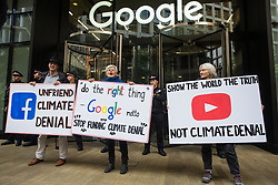 London, UK. 16 October, 2019. Climate activists from Extinction Rebellion defy the Metropolitan Police ban on Extinction Rebellion Autumn Uprising protests under Section 14 of the Public Order Act 1986 by attending a protest outside the Kings Cross headquarters of Google against its role in 'enabling the spread of systematic disinformation on climate change and the ecological crisis'.