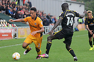 Newport County's Jazzi Barnum-Bobb (l) goes past Crewe's Zoumana Bakayogo. Skybet EFL league two match, Newport county v Crewe Alexandra at Rodney Parade in Newport, South Wales on Saturday 20th August 2016.<br /> pic by David Richards, Andrew Orchard sports photography.