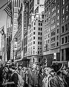 Pedestrians walking down 5th Avenue at corner of 53rd Street, New York City, NY, USA