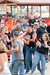HOG members scrambled as t-shirts were cannoned into the crowd at the HOG (Harley Owners Group) party by the pool at the Full Throttle Saloon during the Sturgis Black Hills Motorcycle Rally. SD, USA. Thursday, August 8, 2019. Photography ©2019 Michael Lichter.