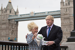 © licensed to London News Pictures. London, UK 07/05/2013. Mayor of London Boris Johnson and EastEnders star Barbara Windsor posing with a tea pot outside City Hall to promote the Big Lunch. Photo credit: Tolga Akmen/LNP